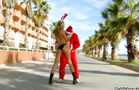 Dude in the Santa costume fucks amazing brunette outdoors